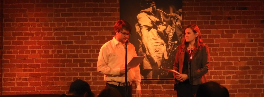 """Ryan Alpers and Julia Halprin Jackson read the prologue to """"The End of Time"""" by Cellista at Cafe Strtich, January 6, 2016. Photo by Leo Alvarez."""