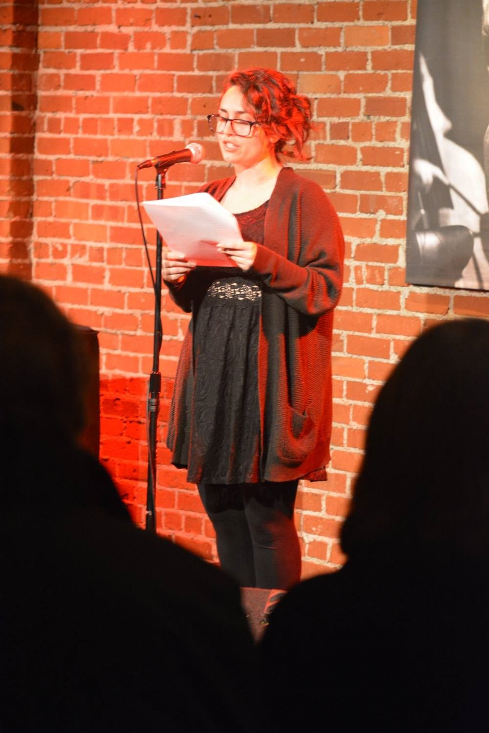 "Melinda Marks reads ""Collectibles"" by Betsy Miller at New Year Nouveau. Photo: Andrew Christian."