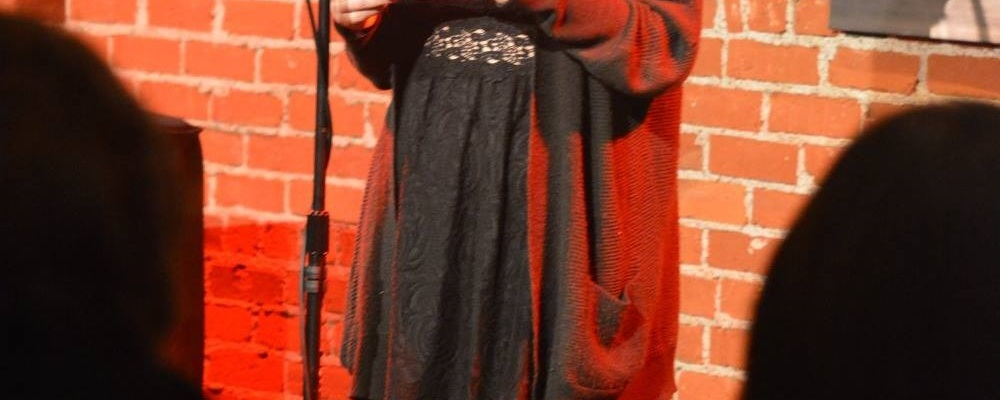 """Melinda Marks reads """"Collectibles"""" by Betsy Miller at New Year Nouveau. Photo: Andrew Christian."""