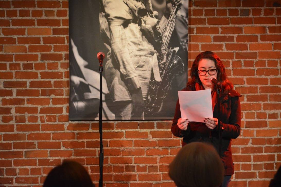 """Ivette Deltoro reads """"Suck it Up"""" by Tania Martin at Cafe Stritch. Photo by Andrew Christian."""